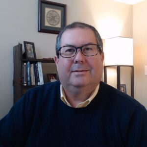 A photo of Gordon Brewer is captured. He is a therapist, podcaster, trainer, speaker and writer. Gordon is featured on the Practice of the Practice, a therapist podcast