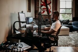 Picture of man podcasting representing podcast equipment needed for private practice