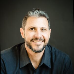 Image of Eric Malzone who is featured in this therapist podcast, speaking to Joe Sanok about making big scary business decisions