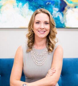 A photo of Dr. Kate Campbell is captured. She is featured on The Grow A Group Practice, a podcast for group private practice owners with Alison Pidgeon. They speak about how to take maternity leave as a business owner.