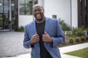 A Photo of Daryll Stinson is captured. He is a former Division 1 athlete, founder of Division 1 Athletes, motivational speaker and leadership coach. Daryll is featured on the Practice of the Practice, a therapist podcast