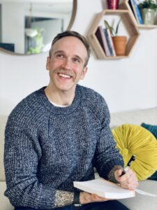 A photo of Paul Levitin is captured. He is a happiness and health coach is a therapist and host of The Happy Healthy Human Podcast. Paul is featured on Practice of the Practice, a therapist podcast.